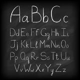 Chalk board hand drawn alphabet. Royalty Free Stock Images