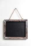 Chalk board. Hanging on a white background stock photo