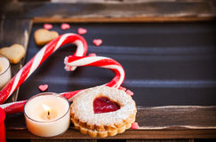 Chalk board and heart shaped candies and cookies Royalty Free Stock Photos
