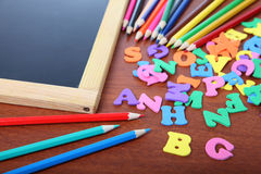 Chalk board, letters and pencils Royalty Free Stock Image