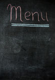 The chalk board menu for a bar or cafe .The drawing on a blackboard. Stock Photos