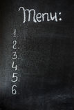 The chalk board menu for a bar or cafe .The drawing on a blackboard. Stock Image