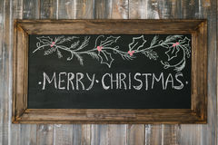 Chalk board with Merry Christmas message Stock Photography