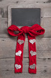 Chalk board for message with red knitted bow and hearts Stock Photos