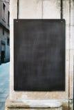 Chalk board mockup. Black chalk board mock up on the white wall stock image