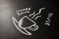 Chalk board with the phrase coffee break Royalty Free Stock Photos