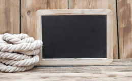 Chalk board and rope Stock Photo