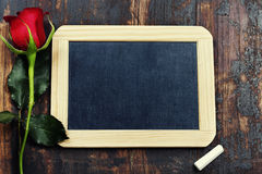 Chalk board and rose Stock Photography