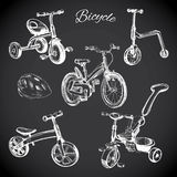 Chalk board set with hand drawn bicycles and balance bike, helme Royalty Free Stock Photos
