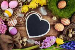 Chalk board in the shape of hearts and Easter Royalty Free Stock Images