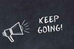 Chalk board sketch with loudspeaker and motivational phrase keep going stock illustration