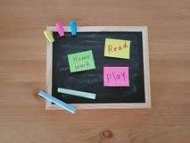 Chalk Board With Sticky Notes, Erasers and Chalk stock photo