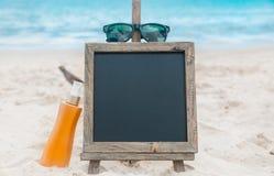 Chalk board sunscreen cream beach tropic exotic Stock Photos