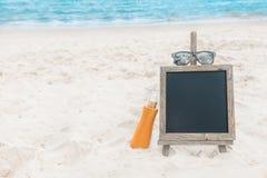 Chalk board sunscreen cream beach tropic exotic Stock Photo