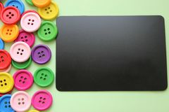 Chalk Board surrounded by colorful buttons royalty free stock images