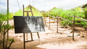 Chalk board at tropical island with nature background stock footage
