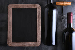 Chalk Board and Wine Bottles Royalty Free Stock Photo