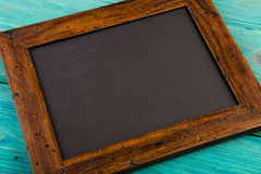 Chalk board on wooden background Stock Photography