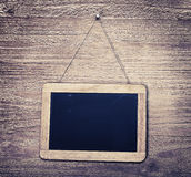 Chalk board. On wooden background in vintage style stock image