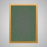 Chalk board with wooden frame on a gray background Royalty Free Stock Images