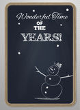 Chalk board with woodframe and hand drawn snowman Stock Images