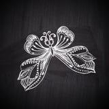 Chalk butterfly on chalkboard blackboard. Ornamental round lace stock image