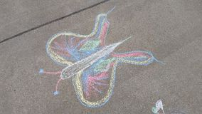 Chalk butterfly. Sidewalk fun with chalk. Draw your butterfly stock images