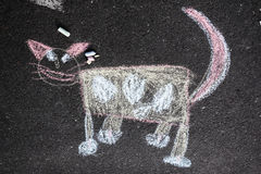 Chalk cat. Cat drawing on asphalt with chalk Stock Photo