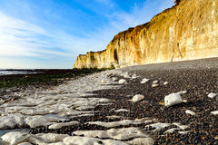 The chalk cliffs beneath Castle Hill, Newhaven Sussex. The cliffs beneath Castle Hill, Newhaven, with Palaeogene sediments resting unconformably on the Upper Royalty Free Stock Images