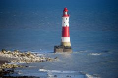 The famous Beachy Head lighthouse and chalk cliffs near Eastbourne in East Sussex, England stock image