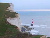 Chalk cliffs and Lighthouse at ocean coastline in England. White Chalk cliffs and Lighthouse at ocean coastline in England Stock Photos