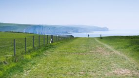 Chalk cliffs, path, Seaford Head, East Sussex, UK. Seaford Head Naturue reserve, East Sussex, England. View of the chalk cliffs, part of Seven Sisters National royalty free stock photos