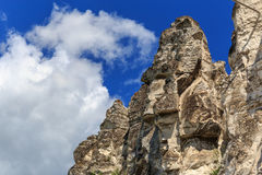 Chalk cliffs or rocks, mountain peak at background blue sky Stock Photos