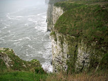 Chalk cliffs with sea spray stock photography
