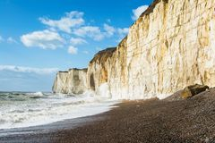 Chalk cliffs between Seaford and Newhaven, England. Chalk cliffs between Seaford and Newhaven, near Tide Mills, East Sussex, Enlgand in a high tide, selective stock images