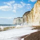 Chalk cliffs between Seaford and Newhaven, England. Chalk cliffs between Seaford and Newhaven, near Tide Mills, East Sussex, Enlgand on a windy day in a high Stock Image