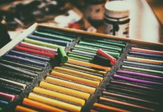 Chalk. Closeup of colorful chalk pastels in a box for drawing. View from above, Retro Style stock photo