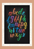 Chalk colorful hand drawn latin calligraphy brush script of lowercase letters on the blackboard. Calligraphic alphabet. Vector Stock Images