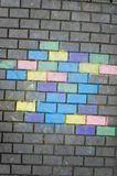 Chalk colors on pavement brick Royalty Free Stock Image