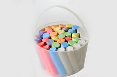 Chalk crayons. A plastic bucket with colorful chalk crayons for painting on the  asphalt Stock Photo