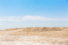 Chalk or Cretaceous quarry, sand or chalk hills against a bright blue sky Royalty Free Stock Photography