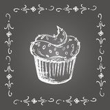 Chalk cupcake with sprinkles and vintage frame. Royalty Free Stock Photo