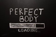 Chalk desk with perfect body loading picture Stock Photo