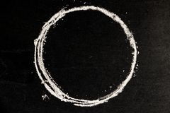 Chalk drawing as circle shape as blank stamp or seal on blackboa Stock Image