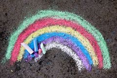 Chalk drawing on asphalt: colorful rainbow. Copy space Royalty Free Stock Photo