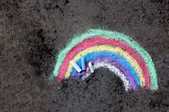 Chalk drawing on asphalt: colorful rainbow. Copy space Stock Photo