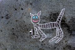 Chalk drawing on asphalt: funny cat. Colorful chalk drawing on asphalt: funny cat, copy space royalty free stock photo