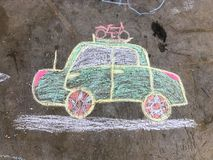 Chalk drawing. Of an automobile going on vacation stock photo
