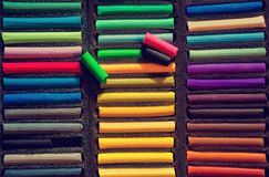 Chalk for drawing. Closeup of colorful chalk pastels in a box for drawing. View from above royalty free stock image