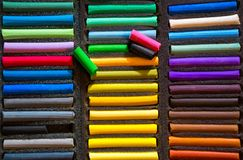 Chalk for drawing. Closeup of colorful chalk pastels in a box for drawing. View from above stock photo